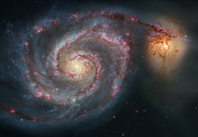 This spiral galaxy (M51) is 60,000 light years across (one light year = 5.8 trillion miles), and it has billions of suns, and is about 30 million light years from Earth. It is one of 3 galaxies that can be seen with the naked eye, this one is near the end of the Big Dipper's handle. The fascinating thing is that M51 is one of trillions of galaxies in this Universe!