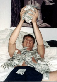 Yes, I'm celebrating life playing in a pile of $20,000! AND YES THOSE ARE ALL $100 NOTES!